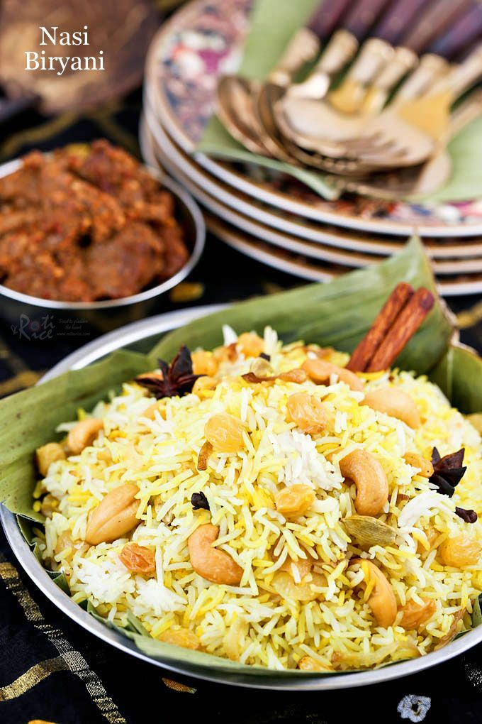 Fragrant and tasty Nasi Biryani flavored with spices and rose or kewra water. This aromatic rice is the base for all your meat biryanis.   RotiNRice.com