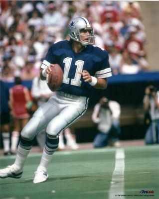 Danny White, 1976 - 1988, played 166 games, position QB. White started 92 games at Quarterback for Dallas, spending his whole career with the Cowboys. He completed 1,761 passes  in 2,950 attempts for 21,959 yards and 155 touchdowns and a career rating of 81.7. White rushed 159 times for 482 yards and 8 touchdowns and caught 3 passes for 18 yards and 2 touchdowns. White also punted for the Cowboys 610 times for 24,509 yards an average of 40.2 yards per punt.