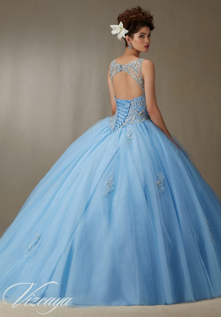 Quinceanera Dress  Vizcaya Morilee 89067 Embroidery and beading on a tulle ball gown  Colors: Bahama blue, Blush, Champagne, and white   A back side view