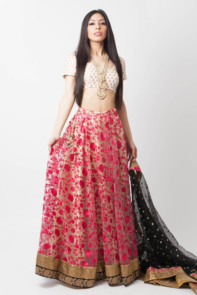 Anaya – holiCHIC. Embroidered lehenga. Beige net lengha with pink thread embroidery pairs with a cream and gold raw silk blouse. Completed with black net embroidered dupatta.#holiCHIC #embroidered #lehenga