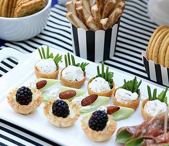Add fun twists to cheese #parties, such as classic stripes, whimsical details, and—of course—delicious cheese! #artofcheese #presidentcheese