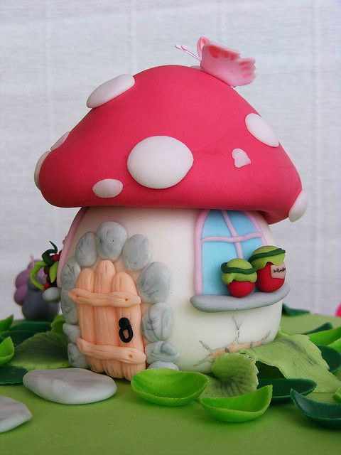 Awesome toadstool house made from Polymer clay . It might even be a cake topper?.  #polymerclay #toadstool #Caketopper?