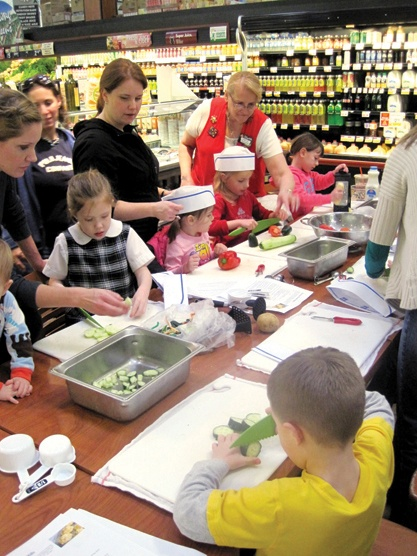 Kids learn to cook at a ShopRite's #KidsCookMonday class. Photo courtesy of Wakefern Food Corps.