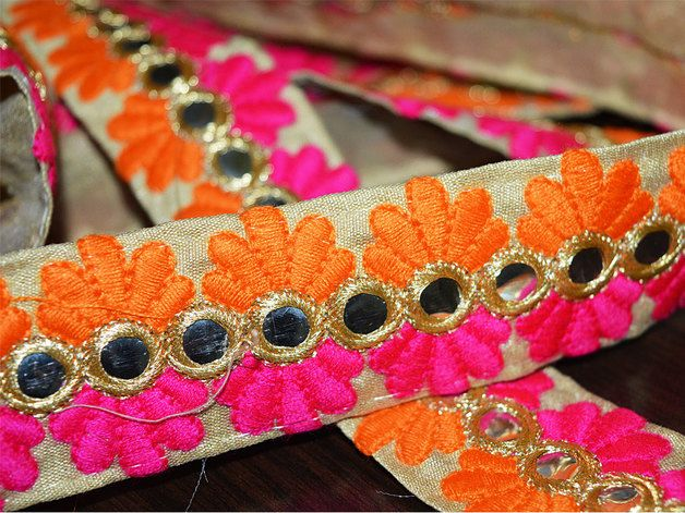 Multi-Color Embroidered floral design Lace in orange, magenta for Silk Sari border. Trim is approx 1.3 inches wide. This stunning lace can be used for designing stylish blouses, shrugs, skirts,...