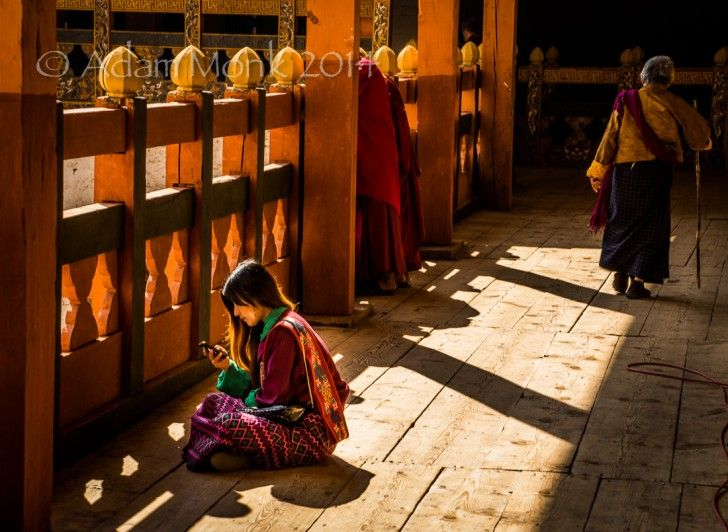 from my 2014 Photographic Tour to Bhutan.  The wonderful contradictions of Bhutan... traditional dress, 800 year old temple, iPhone 5...