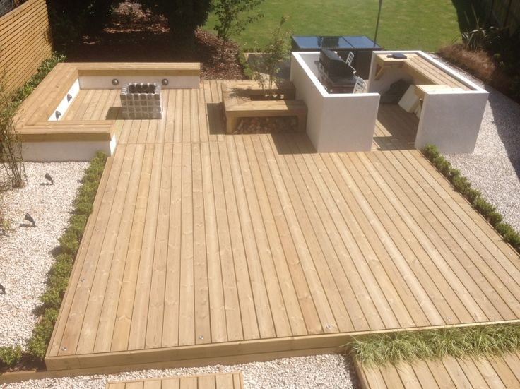 Softwood decking, logstore bench, firepit with seating, BBQ area and softwood screening/cladding.