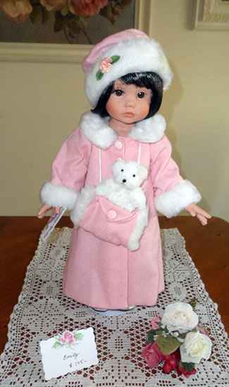 I LIKE THIS DOLL BECUES SHE HAS A TEEDY BEAR