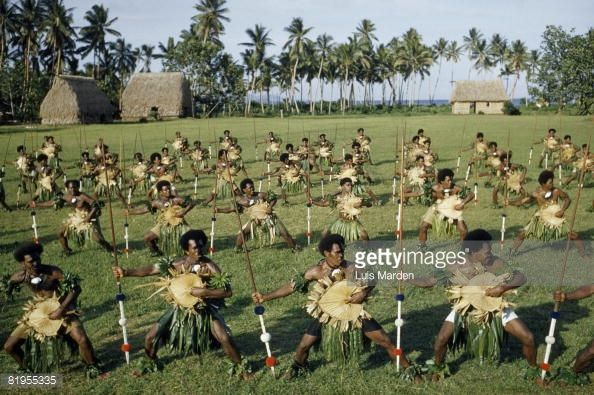News Photo : Dancing men brandish spears and palm-leaf...