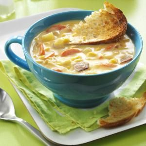 Cheesy Corn Chowder Recipe -I've had this chowder recipe for 30 years, and the whole family really enjoys its cheesy corn taste. It makes a big pot—enough for seconds! —Lola Comer, Marysville, Washington