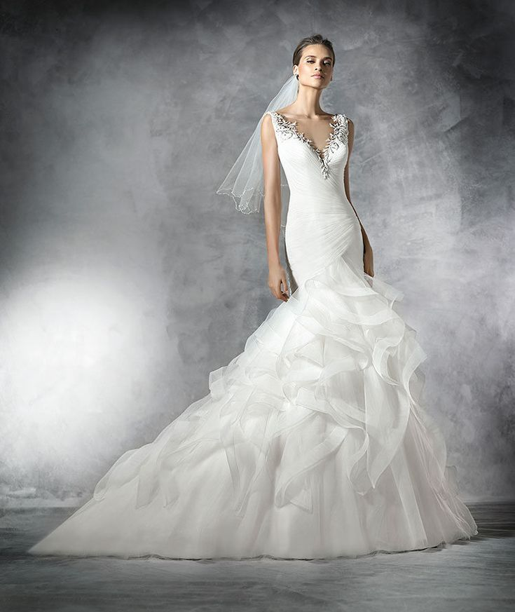 The New Design Mermaid tulle wedding dress. Draped bodice in tulle with V-neckline edged with gemstones. Frilly tulle skirt edged with nylon ribbon. Plunging V at the back with gemstone embroidery trim.  Free Measurement