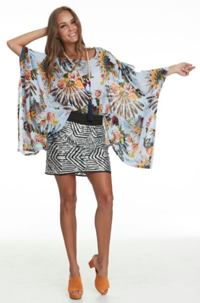 Floaty relaxed floral top with embroidered neckline Relaxed Fit Chiffon Model is 5'9 and is wearing a one size