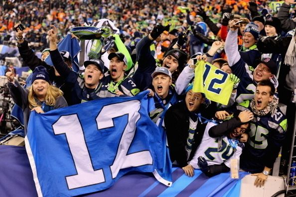 43 Photos Of Seattle Seahawks Fans Celebrating Their First Super Bowl Title. (I also really like the ones in this series of dudes sitting on signs and street lights, and one guy sitting on a sign pointing to the ferrys! That's excellent!! lol)