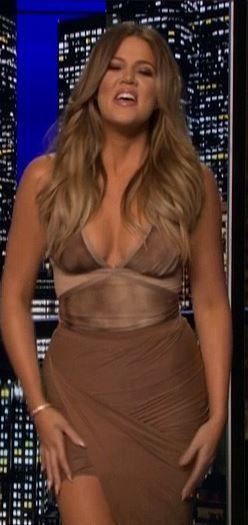 Khloe Kardashian: Shirt – Elisabetta Franchi  Skirt – Caribbean Queen  Shoes – Saint Laurent