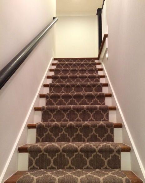 Black Handrails Quatrefoil Pattern On Carpet And Exposed