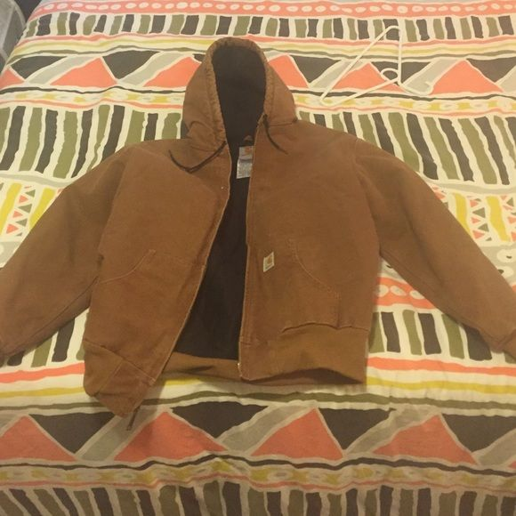Women's Carhartt jacket size L Cotton sandstone duck jacket with quilted flannel lining. Two pockets on the inside. In excellent condition, only work a few times. Size L regular Carhartt Jackets & Coats Utility Jackets