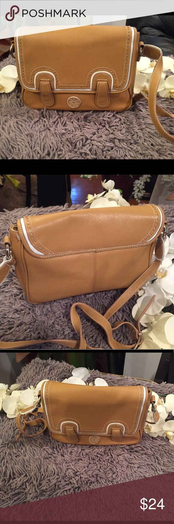 Guess faux leather sandstone strap bag Sandstone  color with white linings  Comes with strap  2 compartments  Minor stain flaws inside bag (see photos)  Preowned but still a good condition and very stylish. Faux leather Guess Bags Crossbody Bags