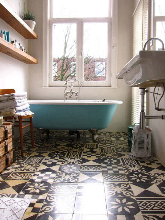 Gorgeous bathroom. In love with the colour of the tub and the patterns on the floor tiles. Great, bright space.