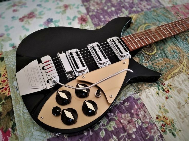 Up for your consideration is a lovely 2007 Rickenbacker model 355 V63. This guitar started out its life as a 350 V63. I added an Accent by Paul Vibrato, gold guards, gold truss rod cover, and stove top knobs for a more vintage appearance. All original parts (i.e. Trapeze tailpiece, factory white guards, and TRC) are included with the sale. The guitar plays spendidly--low, clean action up and down the neck. All electronics work perfectly, and the neck is arrow- straight. The guitar is…