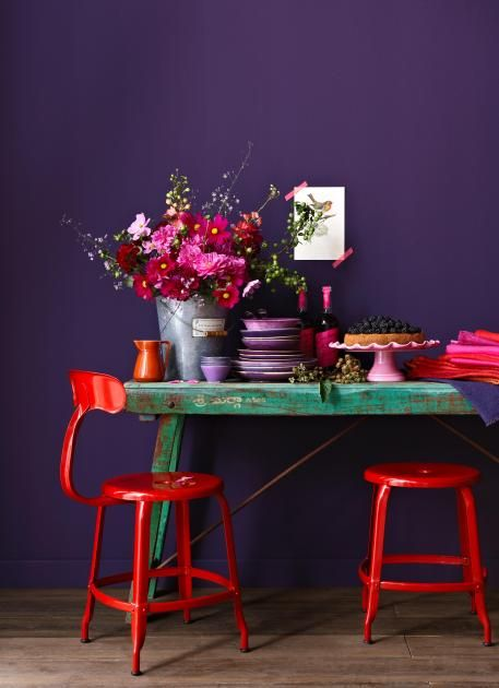 wow! what color..... red chairs against the purple walls and green table. Now... if it only had a mirror. :)