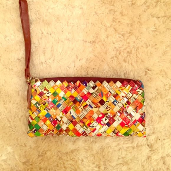Never used! Candy wrapper clutch. Never used. A clutch made out of candy wrappers on the outside, it's cute and shiny! Chestnut leather wrist strap. Brown interior. Bags Clutches & Wristlets