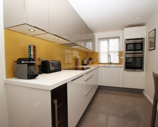 , Contemporary L Shaped Kitchen Ideas With White Modern Kitchen Cabinets Design Also Yellow Glass Backsplash Also Modern Toaster And Oven Also Glossy Gray Tile Flooring Also Windows With Modern Retractable Curtain: L Shaped Kitchen Designs with Beautiful Design