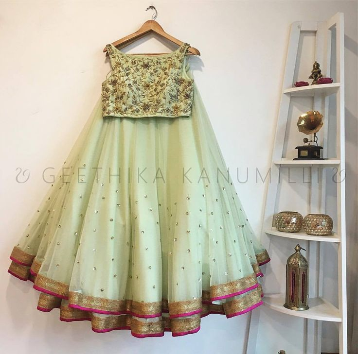 Stunning sea green lehenga and crop top with floret lata design hand embroidery thread work. 23 August 2017