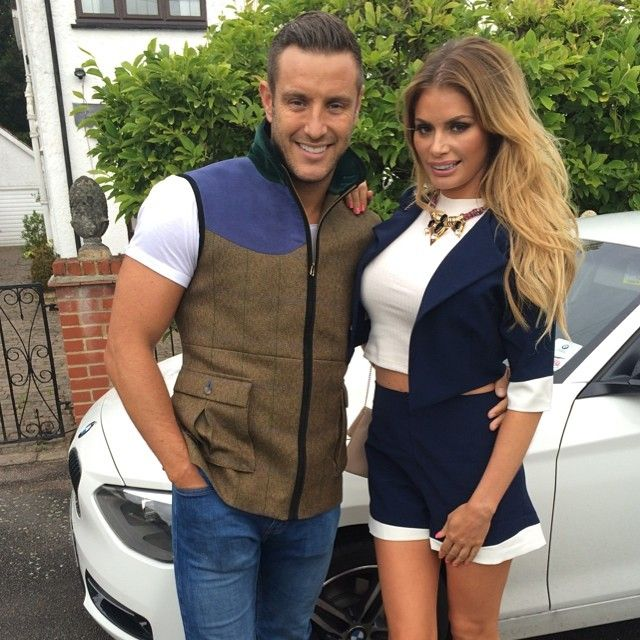 Chloe Sims.. navy jacket and shorts from Hedonia at Lipsy London.. with Elliot Wright..
