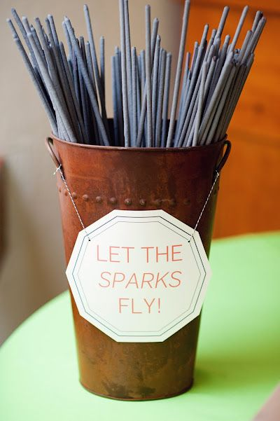 """Let the sparks fly"" Neat wedding favors. Saw one earlier where two or so were together with this phrase written on a card attached to the sparklers."