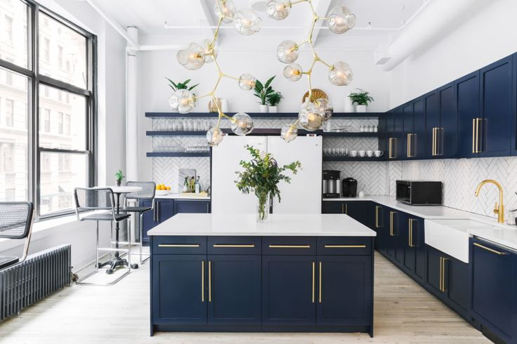 A stunning kitchen, navy cabinetry, brass hardware, and herringbone subway tiling… oh, and a fully stocked bar, naturally!!