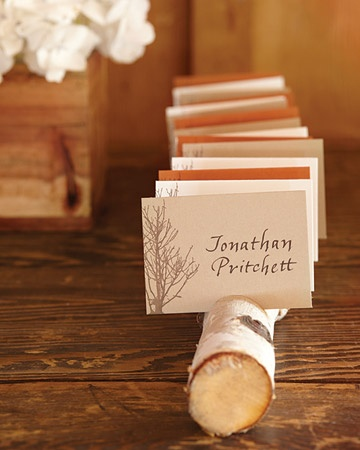cut into half rounds the tree limb would sit steady and I would put their table number in the corner of card
