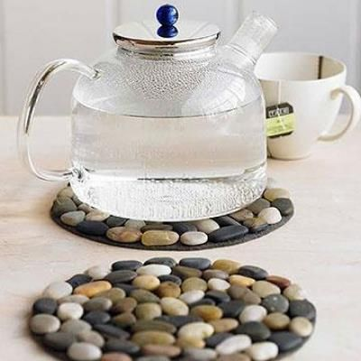 Crafty finds for your inspiration... Glue river stones onto felt to make hot pads.