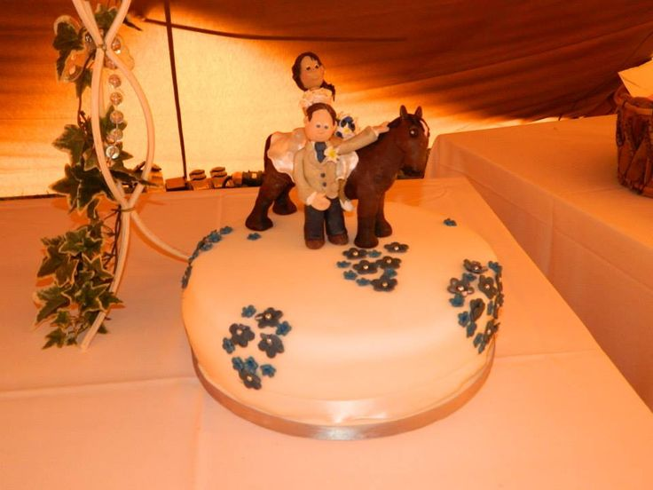 A cake topper for a horse loving bride and groom who wanted their four legged friend on the cake.