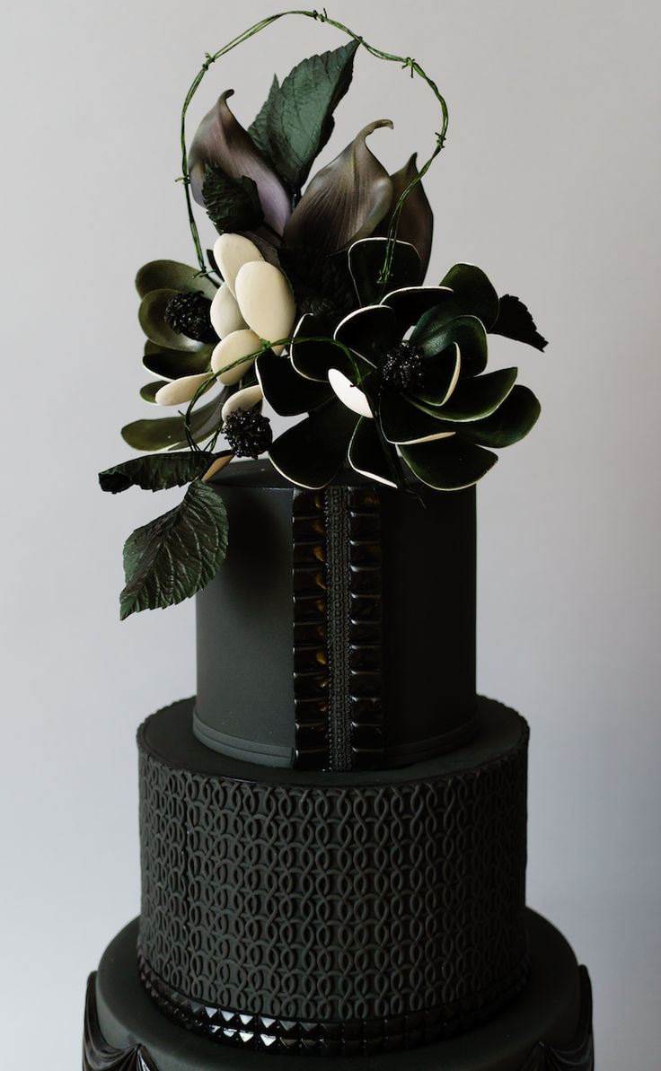 Sleek and modern black on black wedding cake with black sugar flowers made with Satin Ice Cake Studio