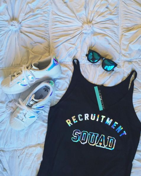 Squad up! Our 2016 #RecruitmentReady shirt is HERE. Featuring our brand-new foil color, Silver Hologram! Black poly viscose tank, with an oversized slouchy fit. Thin straps finish the tank to perfecti