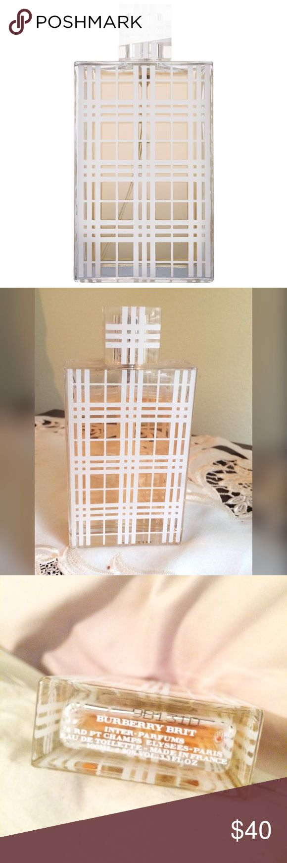 Burberry Brit women's Parfum Burberry Brit 3.3oz women's Parfum. Lightly used and missing about 1/2 from top of the bottle. Burberry Brit is a feminine scent recommended for daytime wear. Does not come with box. Priced to sell! Burberry Other