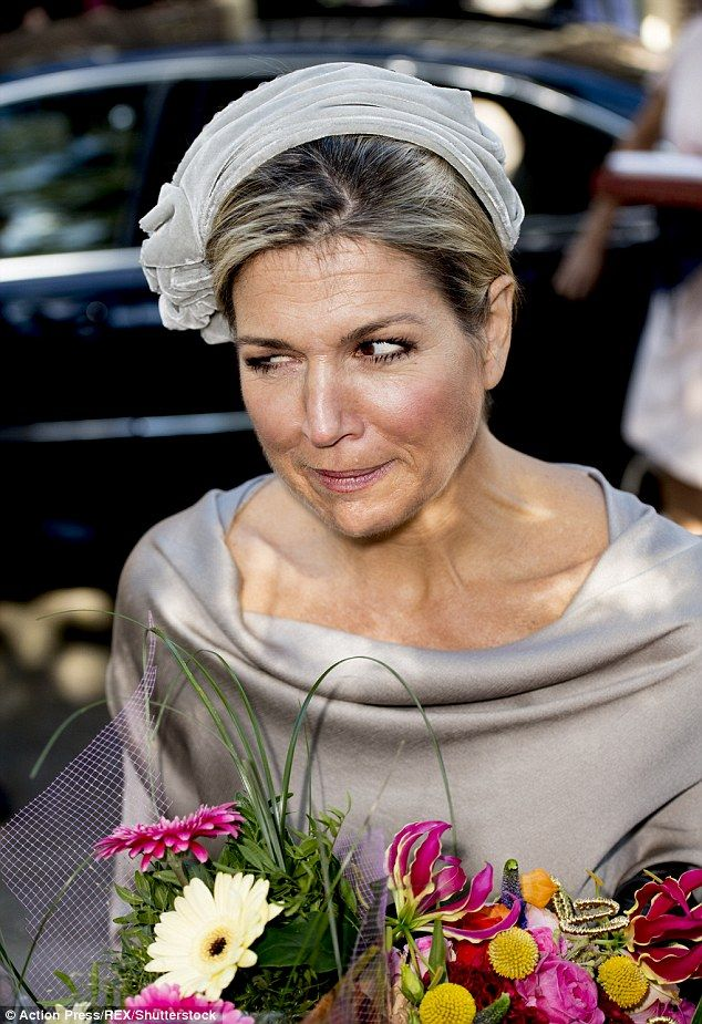 Queen Maxima of the Netherlands was pictured pulling some rather unusual facial expressions during her engagement in Apeldoorn this morning