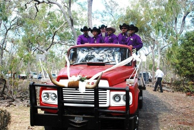 """Even the lads get in on the action...arriving for the ceremony in """"Big Red"""" the cattle truck!"""