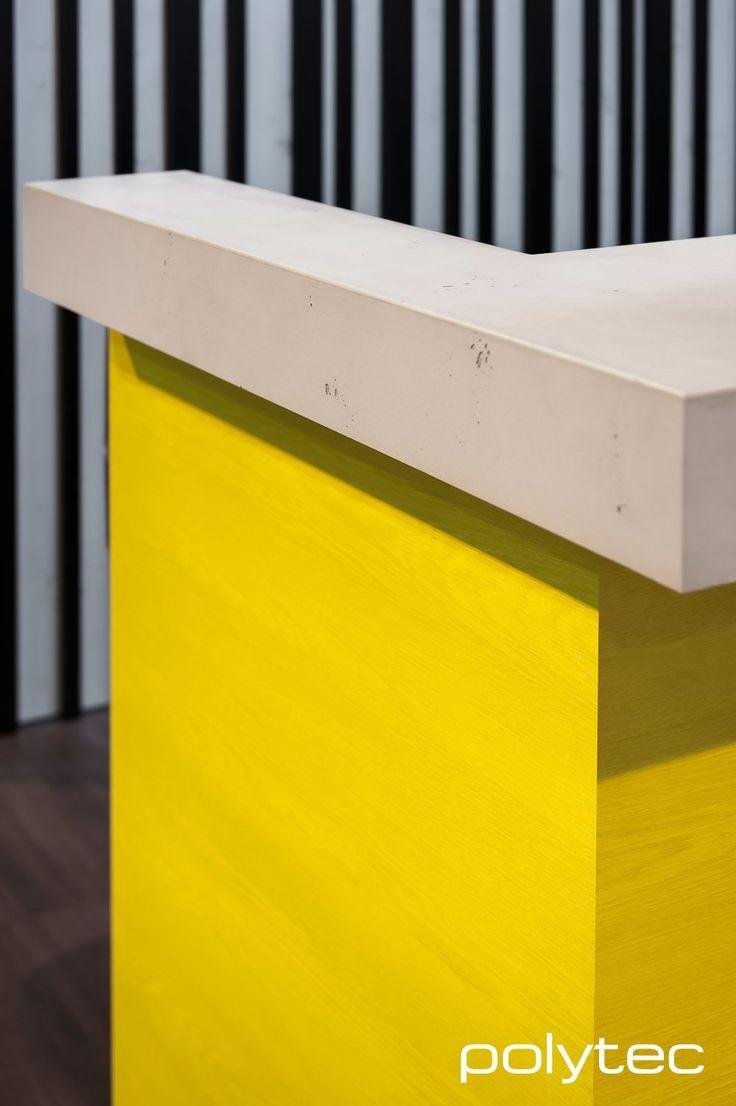 Bench top in imi-beton Plus Grey Concrete.  Bar panel in RAVINE Saffron Oak