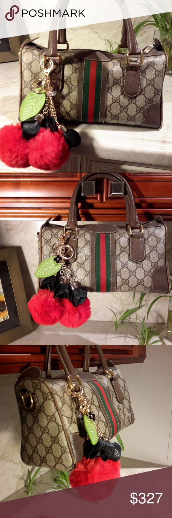 GUCCI Boston Doctor Handbag Red & Green ribbon 100% Authentic GUCCI  Exterior monogram great condition Vintage 1960/70 bag and is NOT perfect but SUPER CUTE!  Comes styled w 2 sets purse key ring charms *  Cherry Cerises Pompoms *  Black leather flowers with LV enamel fleur   Straight stitching, slight strings pulled See pics. Normal pen marks inside, worn corners on bottom  Bottom has 4 feet Zipper works on top & inside pocket Loosed threads/rip of edge by zipper does not affect zipper. Can…