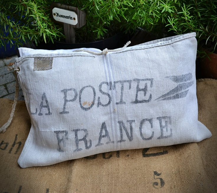 PILLOW INSPIRATION :: La Poste France linen grainsack cushion w/ old washing line tie closures