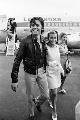 """Romy Schneider with A.Delon, at the airport of Nice, French Riviera, on August 12, 1968, before the shooting of """"La Piscine"""" (""""The Swimming pool"""") by Jacques Deray, in Ramatuelle and Saint-Tropez. Photo by Jean-Pierre Bonnotte / Gamma-Rapho."""