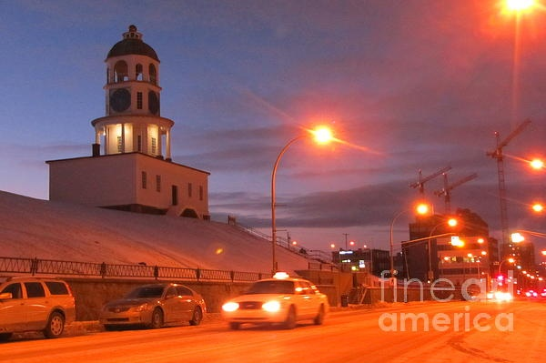 Halifax Nova Scotia's historic Town Clock is a beautiful photograph by Halifax Nova Scotia artist and photograher John Malone. The historic Town Clock in downtown halifax is pictured at sunset just after a light snow fall.