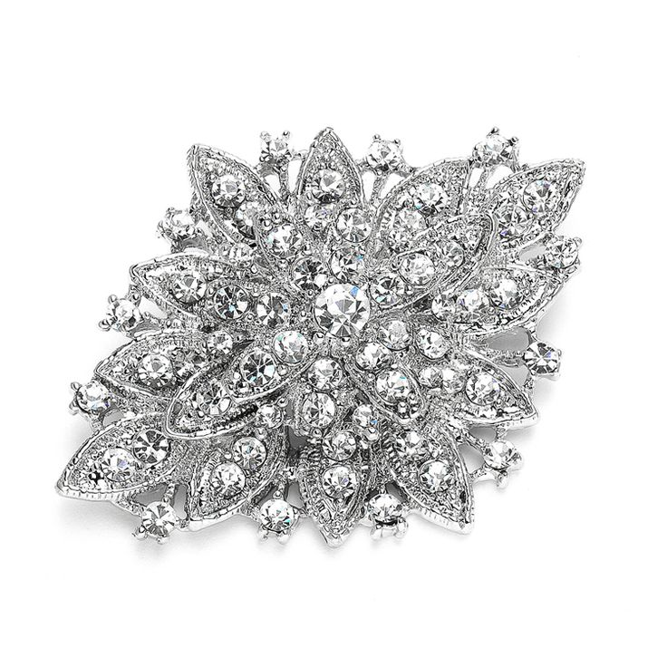 This beautifulbridal brooch set ina sparkling crystal floral design is a great wedding pin for your bridal gown or bridesmaids' dresses. Convert into a beautiful bridal hair comb with our comb adaptor.Just slide the pin through the comb's special loops to create your hair accessory. The comb can removed as desired.
