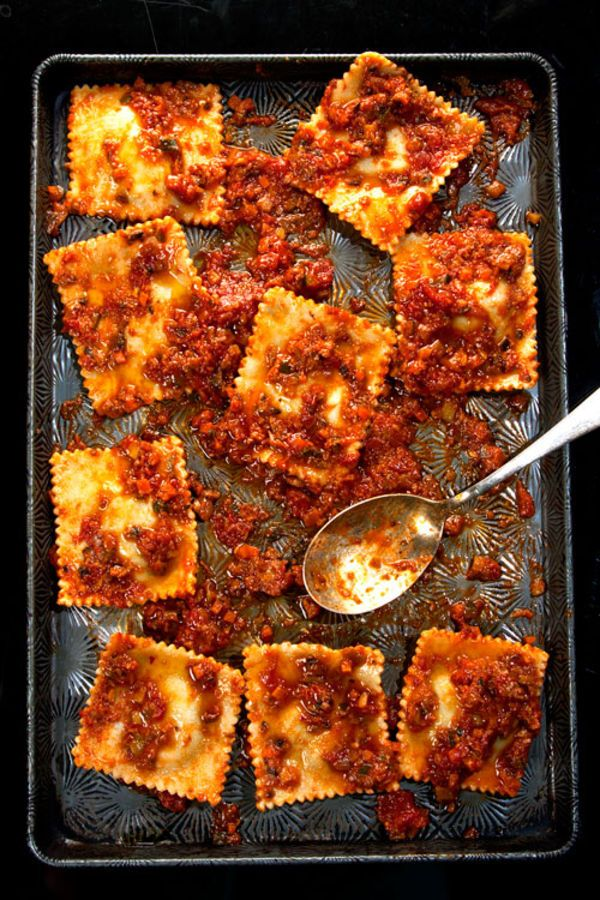 Cheesy, spinach-stuffed ravioli gets a topping of tangy tomato sauce bolstered by mushrooms, zucchini, and squash in this simple, delicious pasta.
