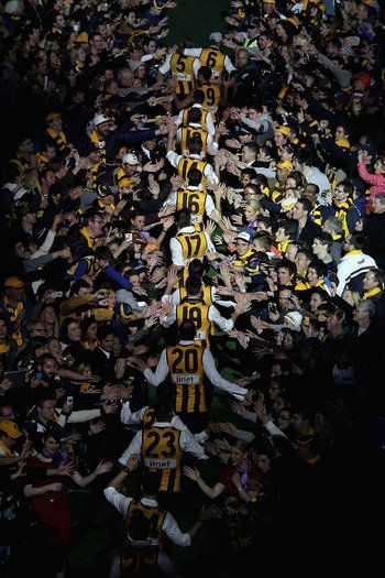 Hawthorn players arrive for the post match AFL Grand Final party at Melbourne Cricket Ground on September 28, 2013 in Melbourne, Australia. (Photo by Robert Prezioso/Getty Images)