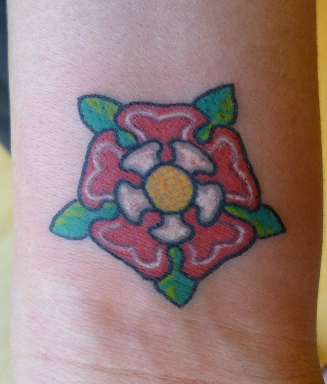 Tudor rose tattoo on wrist. Exactly where I want mine.