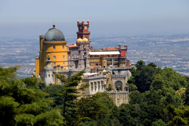 Estoril Coast Drive & Sintra, Portugal-National Palace of Sintra has parts dating back to the 14th century.