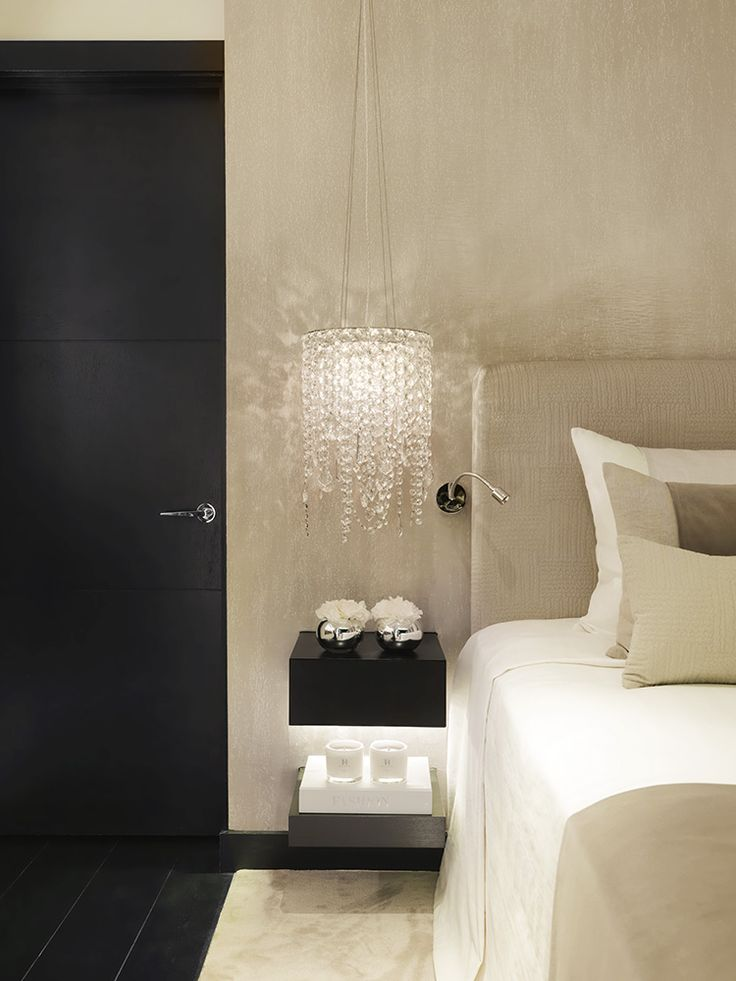 black floating shelving beside bed and chandelier pendants | Kelly Hoppen. London - Pied A Terre.