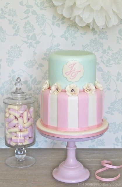 mint green with pink and white stripes cake. One day I will learn how to make these!