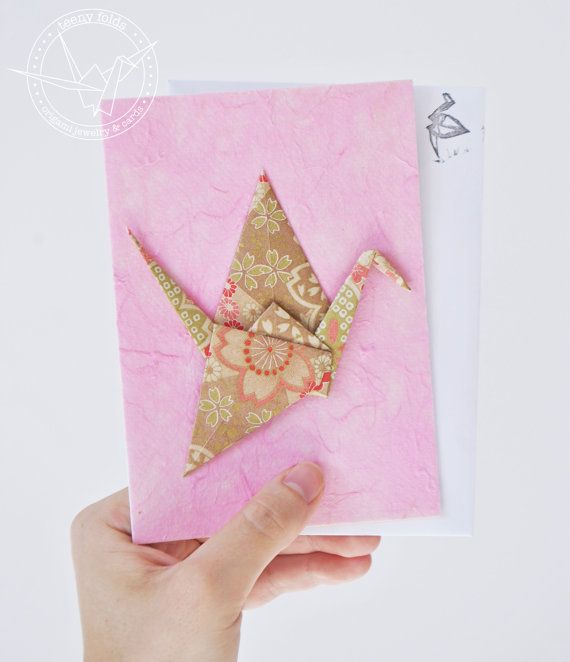 Introducing new origami greeting cards at the Teeny Folds shop on Etsy. These handmade cards are blank on the inside, making it perfect for any greeting, any occasion. This beautiful card is a golden peace crane on pink card. #etsy #origami #crane #stationery #handmade #cards